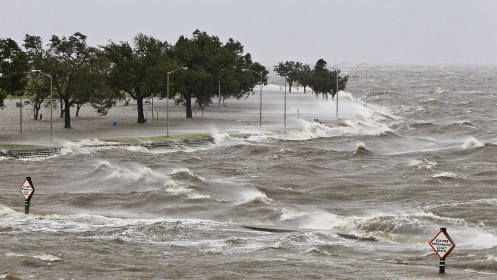 During Hurricane Isaac, a storm surge causes tides to quickly rise while rough waves pound the concrete seawall along the shores of Lake Pontchartrain.